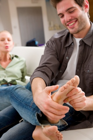 man massaging woman's feet Stock Photo - 12898090