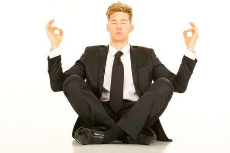 sat: businessman doing yoga Stock Photo