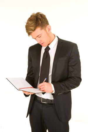 taking notes: businessman taking notes