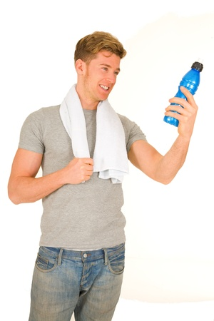 standing water: young man with energy drink
