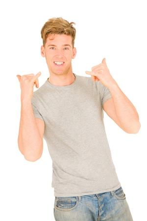 hang loose: Young man making hang loose hand signals
