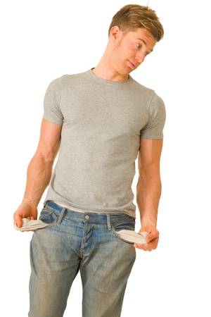 empty pockets: Young man with empty pockets