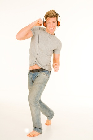 young man with headphones dancing Stock Photo - 14934764