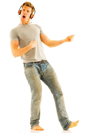 young man with headphones dancing photo