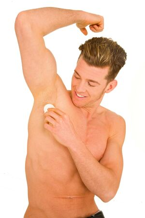 armpits: Young man applying deodorant