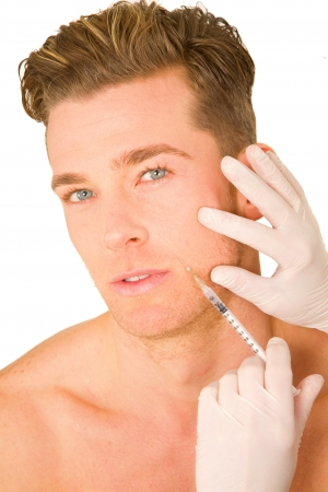 young man doing botox injections