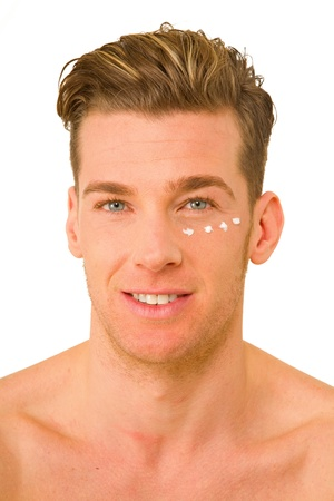 only one man: young man with anti-wrinkle cream