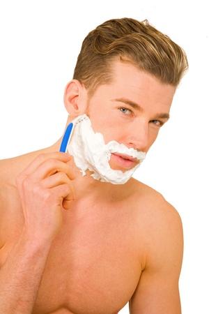 Young man shaving photo