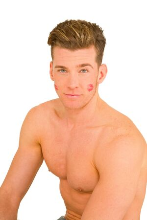 lipstick kiss: young man with the imprint of a kiss on the face