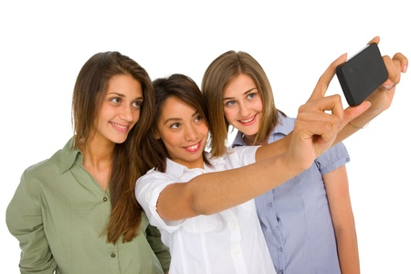 teenager girls with smartphone photo