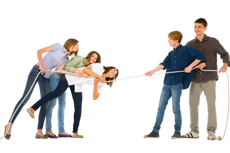 pulling rope: teenagers playing tug of wa