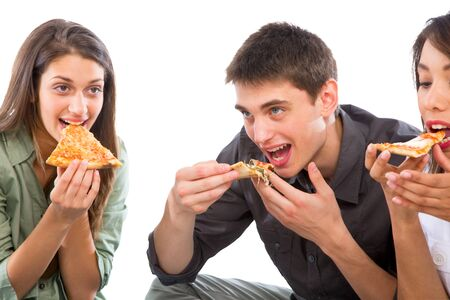 teenagers eating pizza photo
