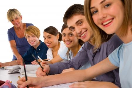 profesor alumno: adolescentes en el aula Foto de archivo