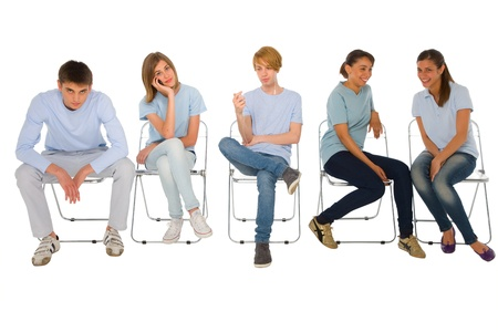 adolescence: teenagers sitting on chairs Stock Photo