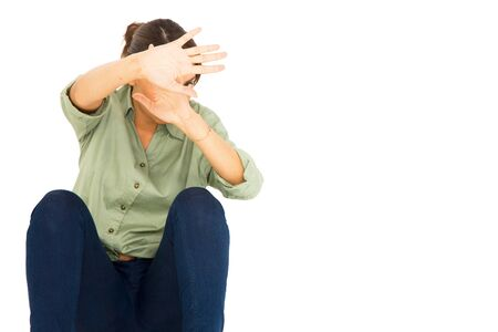 stop gesture: teenage girl protect herself with arms in front of face