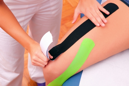 neuromuscular: dynamic functional bandage with taping Stock Photo
