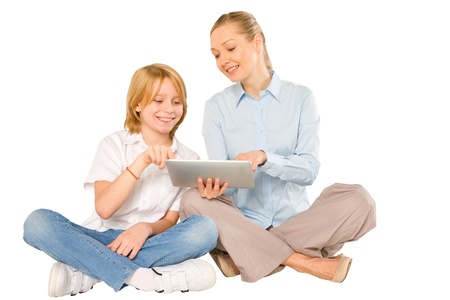 10 years old: mother and son sat on floor with tablet isolated on white background
