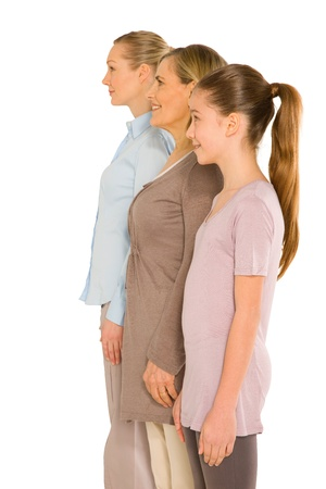 three women: granddaughter grandmother young mother standing on white background