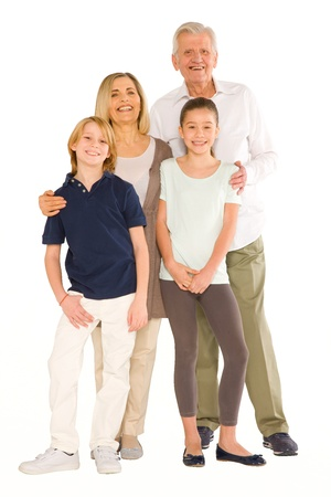 young grandmother and grandfather with nephew and niece standing on white background photo