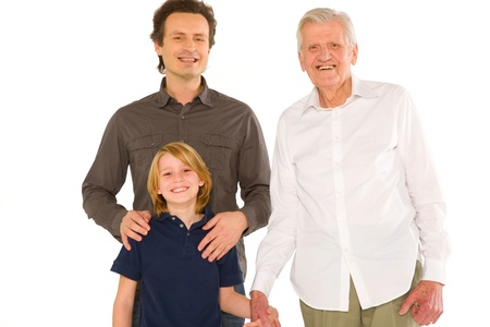 three generations: father gandfather with son nephew standing on white background