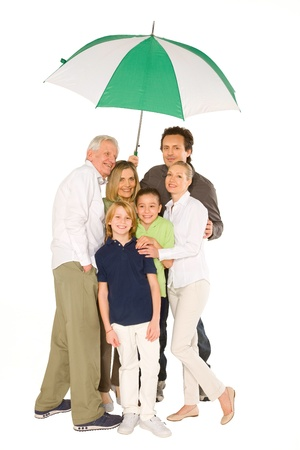 three generations: three generations family standing isolated on white background holding umbrella