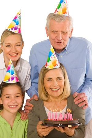 grand kid: family celebrating birthday party with cake Stock Photo