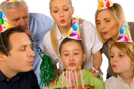 family celebrating birthday party with cake blowing candels Stock Photo - 20588172