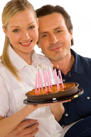 couple celebrating birthday with cake photo