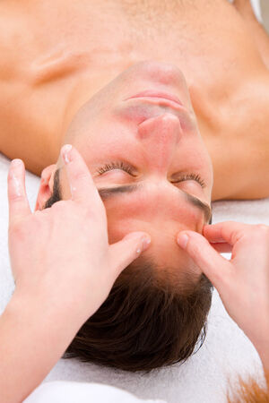 self indulgence: Man the spa center having head massage Stock Photo