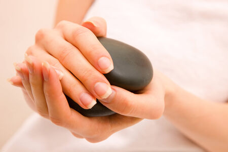 zen interior: Close-up of woman holding stones Stock Photo