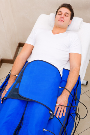 legs pressotherapy machine on man in beauty center