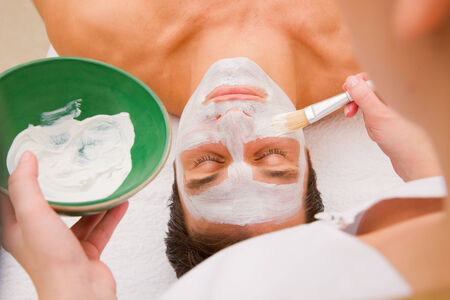 self indulgence: Facial beauty treatment by an aesthetician Stock Photo