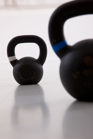 Two black iron kettlebell for weightlifting and fitness photo