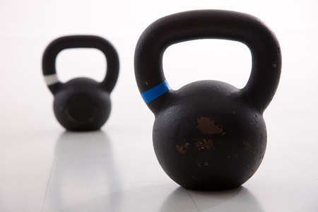 Kettlebells weights in a workout gym photo