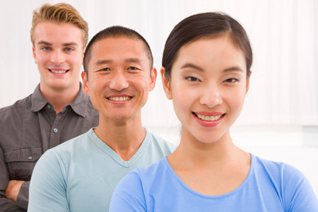 small group of people: Close-up of successful multi ethnic young people