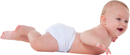 lying on his tummy: A photo of cute toddler smiling Side view of baby boy is lying on his tummy He is wearing diaper isolated over white background Stock Photo