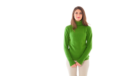 woman sweater: Portrait of happy young woman. Beautiful female is wearing green turtleneck sweater. She is standing isolated on white background.