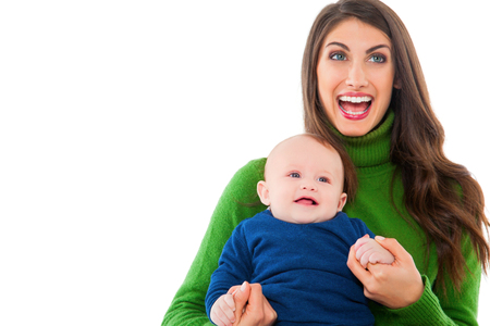 casuals: A photo of cheerful woman with baby boy. Happy mother and son are wearing casuals. They are spending leisure time isolated over white background.