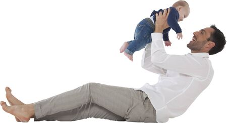 spending full: Full length of happy father playing with baby boy Young man with son spending leisure time Both are in casuals isolated over white background Stock Photo
