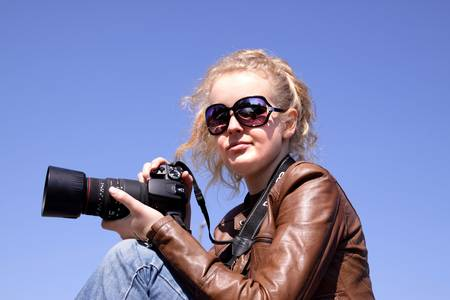 telezoom: girl with camera Stock Photo