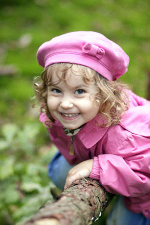 The charming and cheerful little girl playing outside photo
