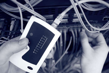 working area: IT is testing a network switch on the server