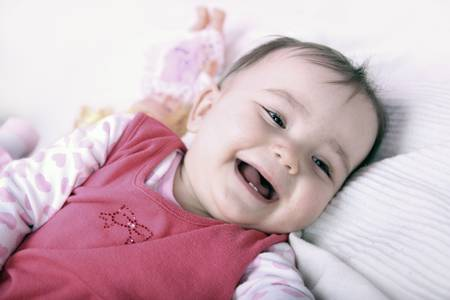 Happy baby lying on the bed