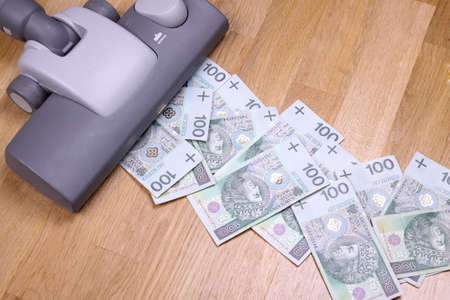 Vacuuming money polish money - PLN currency photo