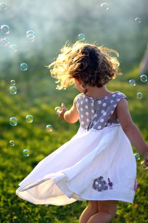 Little girl dancing outside Stock Photo