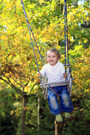 recollections: Girl playing on a swing
