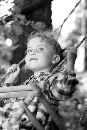 recollections: Pretty girl playing on a swing