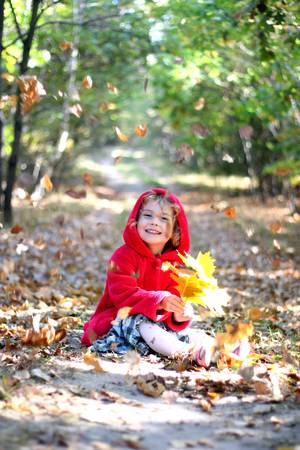 The little girl in a red cap photo