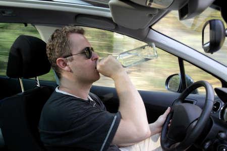 Drunk guy drives a car photo