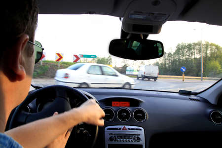 Travelling by car on driver Stock Photo - 13625363